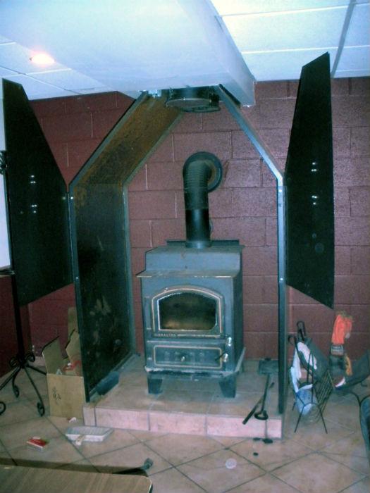 wood stove inside custom framed housing