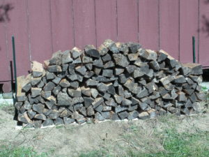 stacked woodpile of dry seasoned split firewood