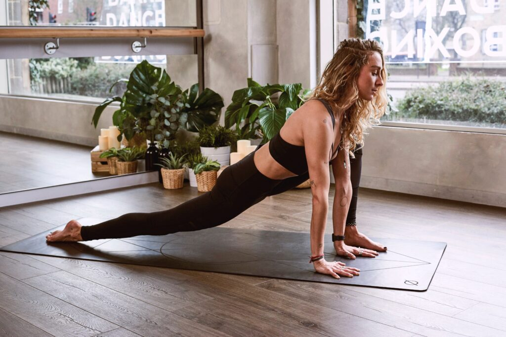 girl on yoga mat exercising