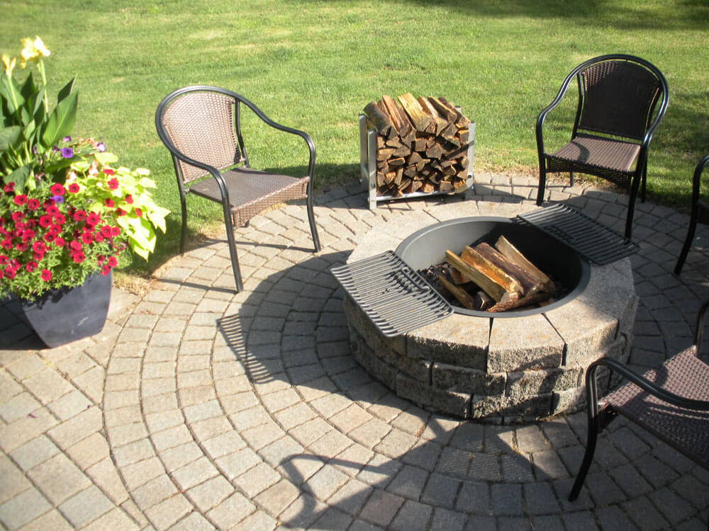 TFH-1 firewood holder holding wood on beautiful outdoor patio next to furniture