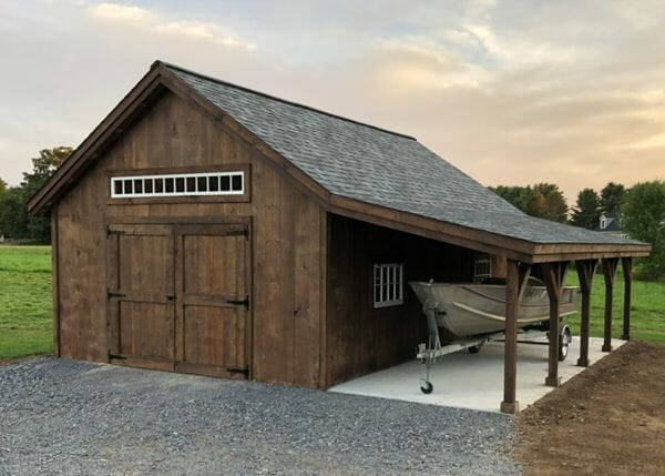 cabin with boat stored along side under roof